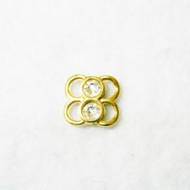 Conector dorado con cristales