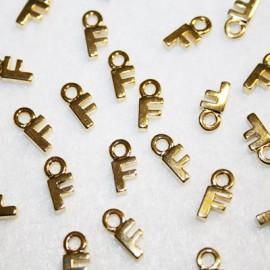 Letra F dorada