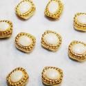 India dorada con resina crema