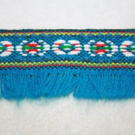 Étnica con flecos turquesa. Se vende por medios metros