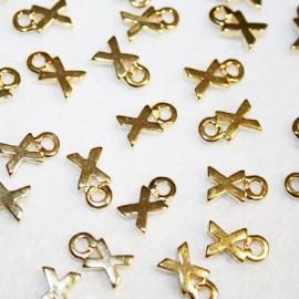 Letra X dorada
