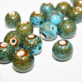 Bola de cerámica azul y verde seco