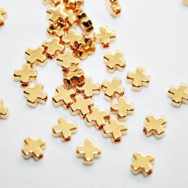 Cruz pequeña pasante dorada